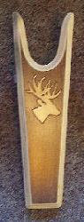 Beautiful wooden bootjack from Rawhide Gifts shows a light oak deer head silhouette on a dark background bootjack