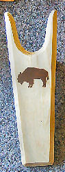 Dark Buffalo silhouette on a light wooden bootjack speaks to the native american prairie west past