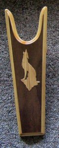 Sturdy Pine Boot Jack (boot pull) dark background and light colored Oak Coyotoe sillhouette- Rawhide Gifts and Gallery