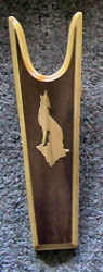 Rawhide Gifts Wooden Bootjack with a light oak coyote silhouette on a dark background