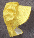 Girl's SunBonnet-bright yellow, tiny red polka dots scattered on bkgrd-Rawhide Gifts and Gallery