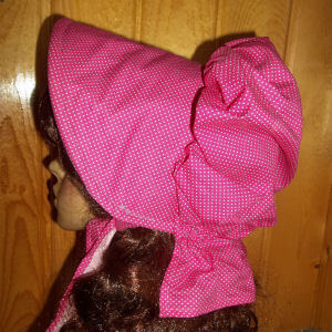 Sizzling hot pink ladies bonnet with tiny white polka dots