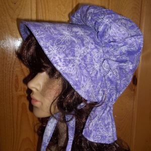 Rich lavender purple ladies bonnet with dragonfly print