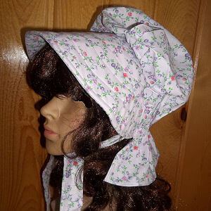 Spring  like ladies summer bonnet with tiny multicolored flowers