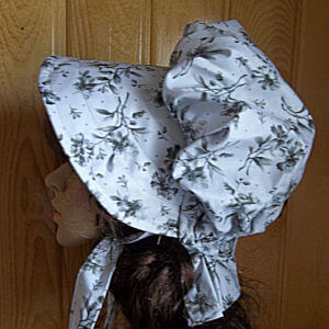 Cream with gray and black floral print is a classy ladies bonnet
