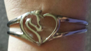 Topsdie showing the horse emblem on the  Equestrian Heart Ladies Silver Bracelet REVIEW