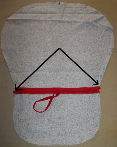 Pin the drawstring ends to the ends of the button bonnet casing