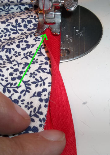 Sewing the binding beneath for the bonnet brim