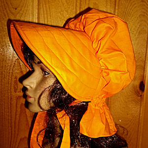 sun bonnets for ladies-Bright and flashy pumpkin orange bonnet looks great on brunettes