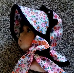 Newborn Button Bonnet side view
