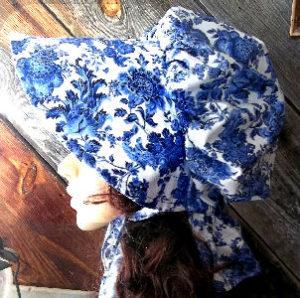 Delft Blue Colored Ladies sunbonnet with bright blue flowers