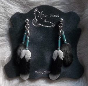 Carved Bone feather earrings with blue bead dangles