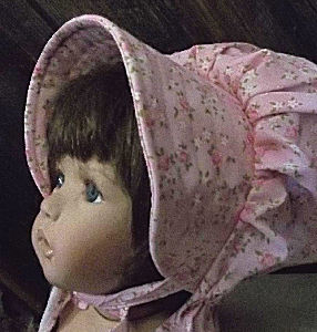 soft shell pink babys bonnet with roses