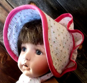 Snap bonnet with pink trim. Pink roses on white seersucker, Baby bonnet