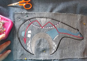 Pin the applique to the shirt or jacket
