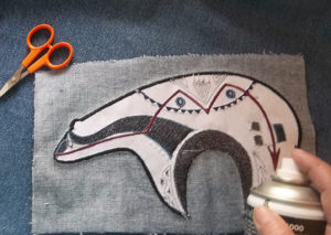 Spray or Pin the zuni bear applique to your project
