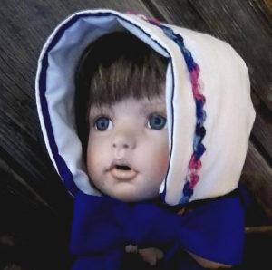 Hamd crocheted blue ric rac baby bonnet front