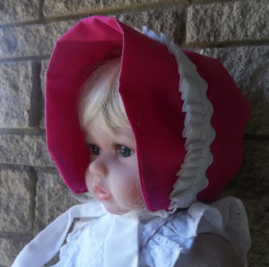 White Pleated Ruffle on Pink baby bonnet-front