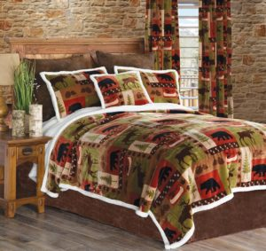 cabin lodge style quilt duvet in greens, reds, bordered with white. Strinking